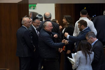 MK David Amsalem celebrates with fellow lawmakers at the Knesset, December 27, 2017.