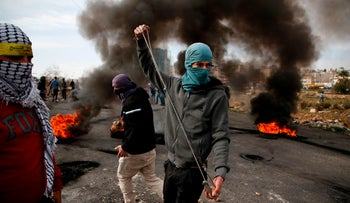Palestinian protestors clash with Israeli security forces following the weekly Muslim Friday prayers in the West Bank city of Ramallah on December 29, 2017.