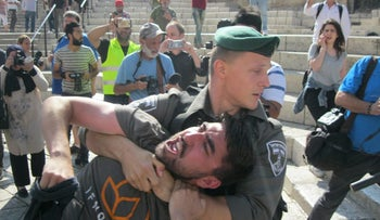 Yonah Lieberman, founder of the IfNotNow organization, being dragged away by a police officer from a recent anti-occupation protest in Jerusalem