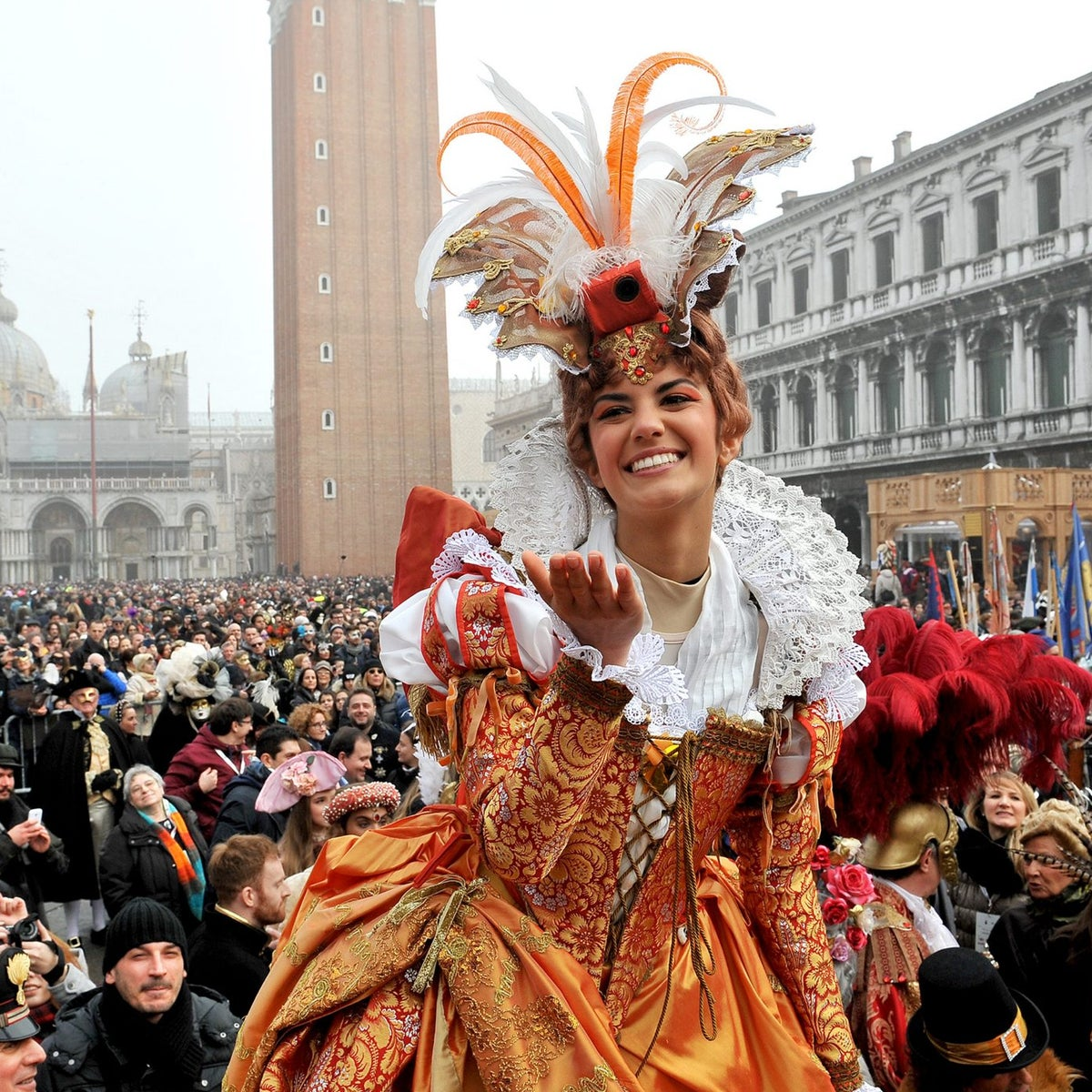 A costumed reveler in St. Mark's Square blows a kiss during Venice's Carnival celebrations. Celebration of the 500th anniversary of its Jewish ghetto begins on March 29, 2016, and will feature a host of cultural events.