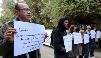 Activists hold placards during a memorial for Giulio Regeni outside of the Italian embassy in Cairo, Egypt, February 6, 2016.