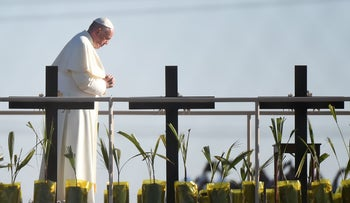 Pope Francis prays for all who died trying to cross from Mexico to the U.S. at the border between the countries, February 17, 2016.