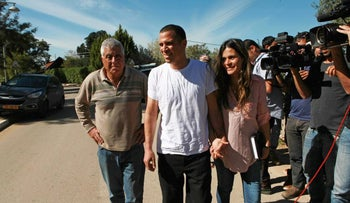 Nir Somech with his wife and father, near their home in Lachish, February 18, 2016.