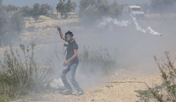 A Palestinian during clashes with Israeli forces in Bil'in on Friday, Feb. 19, 2016.