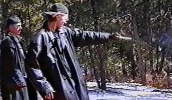 Eric Harris, left, watching as Dylan Klebold practices shooting a gun at a makeshift shooting range in Douglas County, Colorado, March 6, 1999.