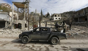 Forces loyal to Syria's President Bashar al-Assad drive a vehicle mounted with an anti-aircraft weapon in the town of Rabiya after they recaptured the rebel-held town January 27, 2016.
