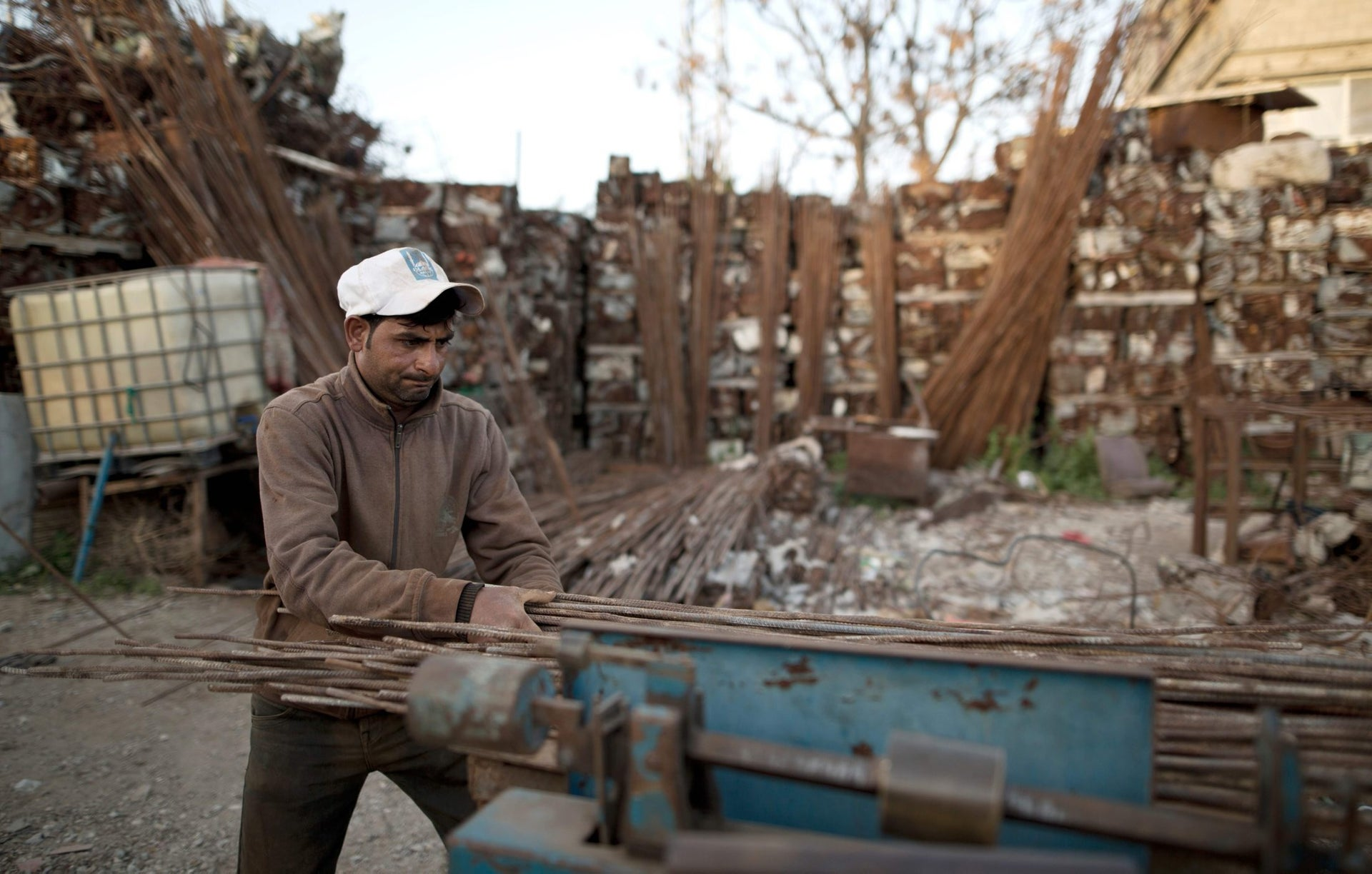 A Palestinian worker brings together metal sticks in East Gaza City, on February 20, 2016.