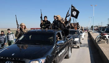A file photo released on May 4, 2015 on a militant website of ISIS militants passing by a convoy in northeast Syria.