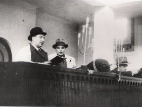 The late Francisco Bráz Rodrigues praying with another congregant at the Mekor Haim synagogue. He was one of the founders of the contemporary Jewish community of Porto.