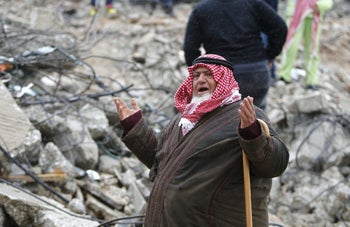 A Palestinian man gestures as he talks to the media on the rubble of of Palestinian Raed Masalmeh's home after it was demolished by Israeli army in the West Bank town of Dura, south of Hebron February 23, 2016.