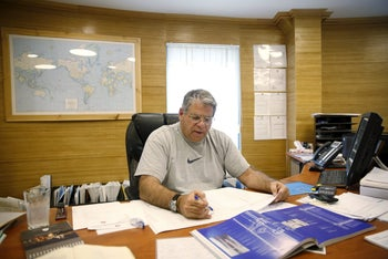 Rami Bone, owner of company Aluminum Construction, works at his office located in the Industrial Park of the West Bank Jewish settlement of Maale Adumim, near Jerusalem, February 3, 2016.