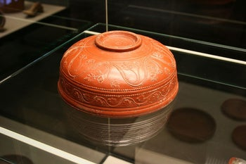 A fineware Roman red-gloss terra sigillata bowl, with elaborate relief decoration,