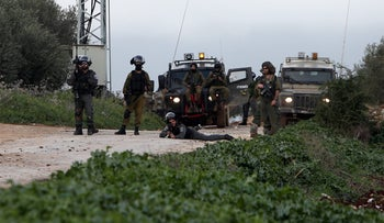 An Israeli Border Policeman takes aim during clashes with Palestinian protesters in the city of Qabatiyah, near the West Bank town of Jenin,on February 22, 2016.