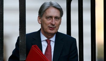Britain's Foreign Secretary Philip Hammond heads to a cabinet meeting in London on February 23, 2016.