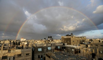 A rainbow is seen over houses in Khan Yunis in the southern Gaza Strip, February 10, 2016.