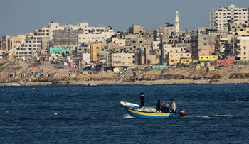 Palestinian fishermen and women sail a boat at the coast of the Mediterranean Sea in Gaza City, Feb. 9, 2016.