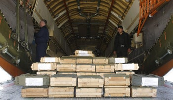 Boxes of ammunition are seen inside a Russian aircraft at the International Kabul Airport, Afghanistan February 24, 2016.