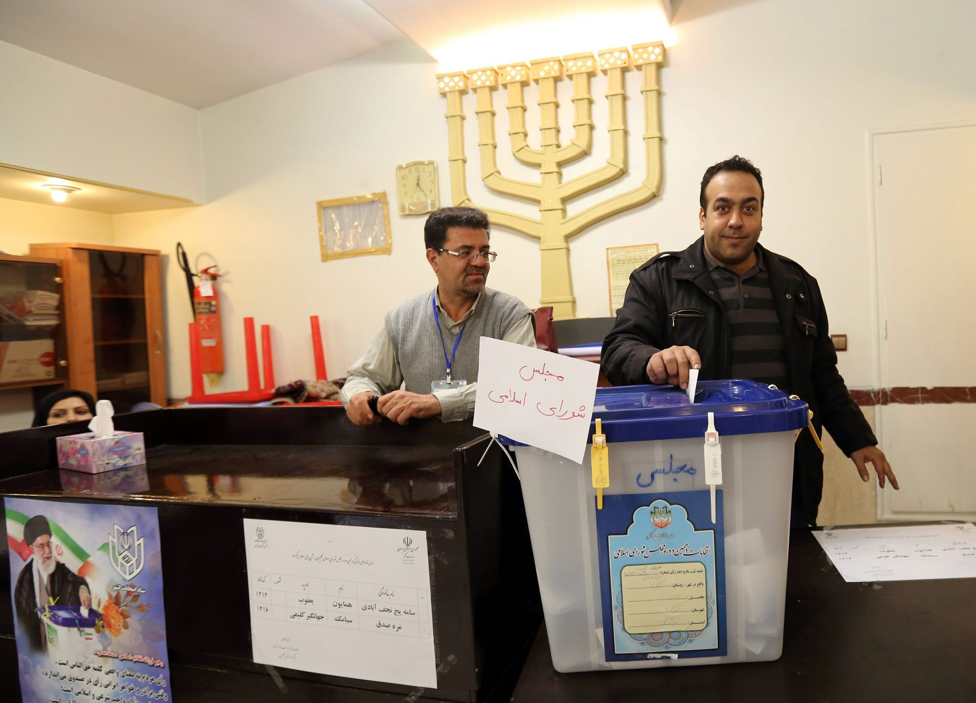A Jewish Iranian casts his vote at a synagogue used as a polling station for the Jewish community in Tehran on February 26, 2016.