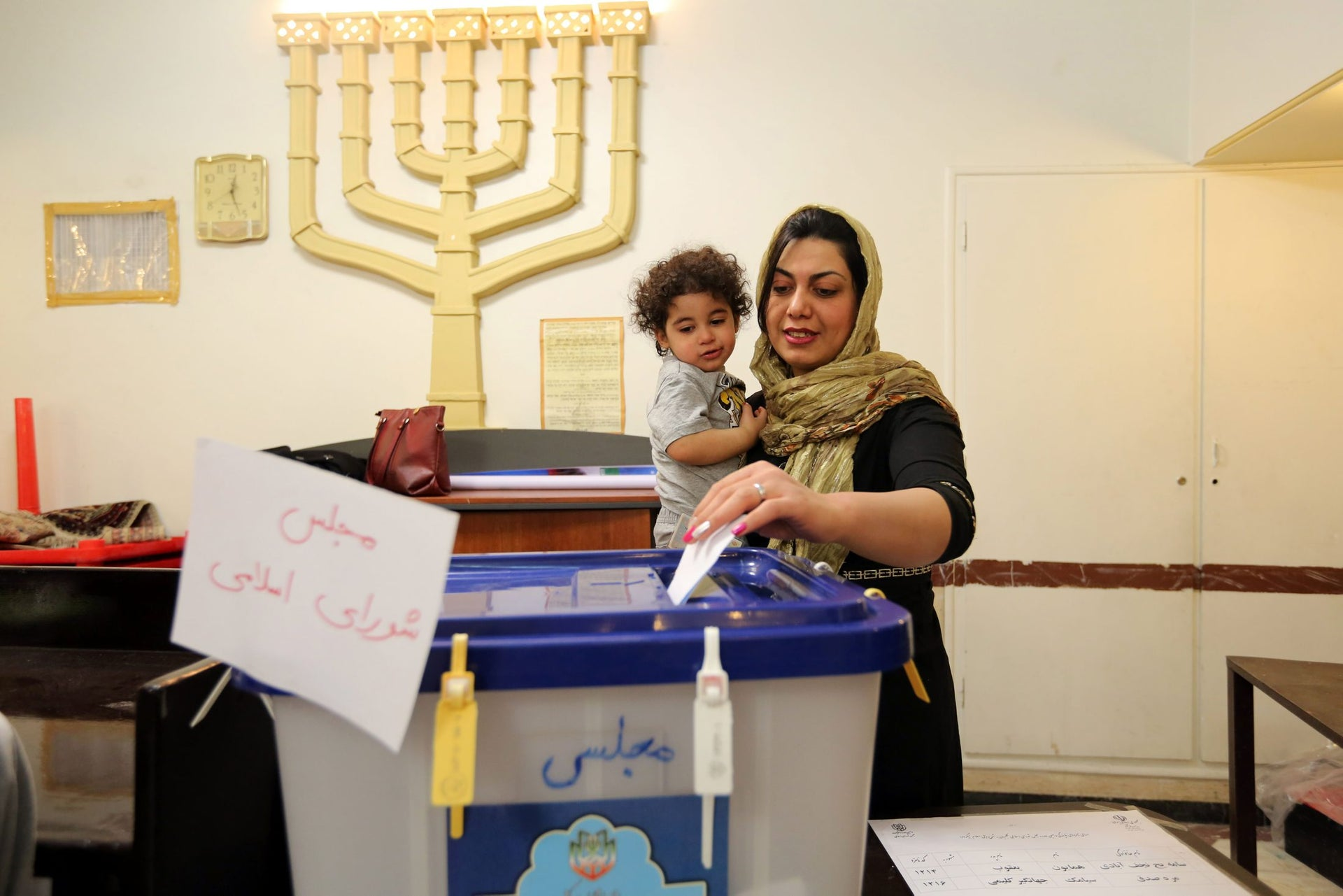 A Jewish Iranian woman casts her vote at a synagogue used as a polling station for the Jewish community in Tehran on February 26, 2016.