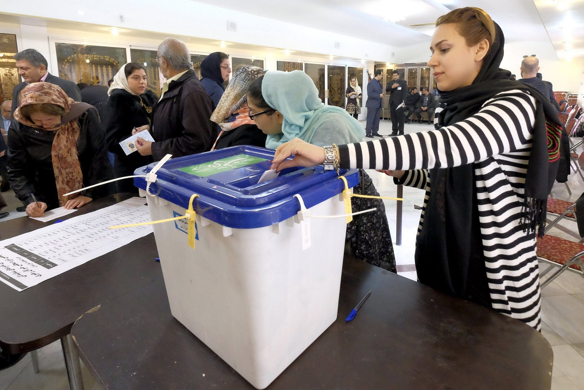 An Iranian Jewish woman casts her ballot at a synagogue, used as a polling station, during elections for the parliament and Assembly of Experts, which has the power to appoint and dismiss the supreme leader, in Tehran February 26, 2016.