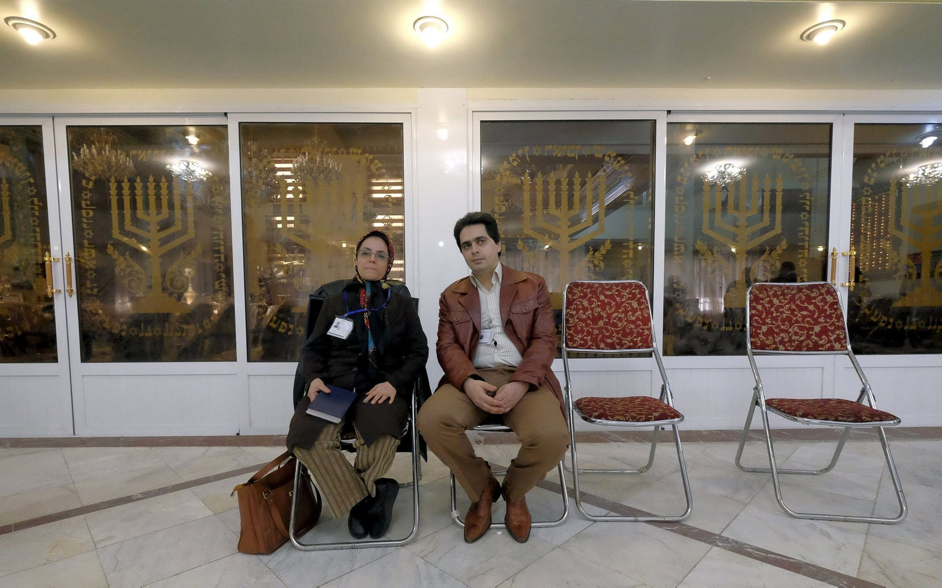 Iranian Jewish election officials rest at a synagogue, used as a polling station, during elections for the parliament and Assembly of Experts, which has the power to appoint and dismiss the supreme leader, in Tehran February 26, 2016.