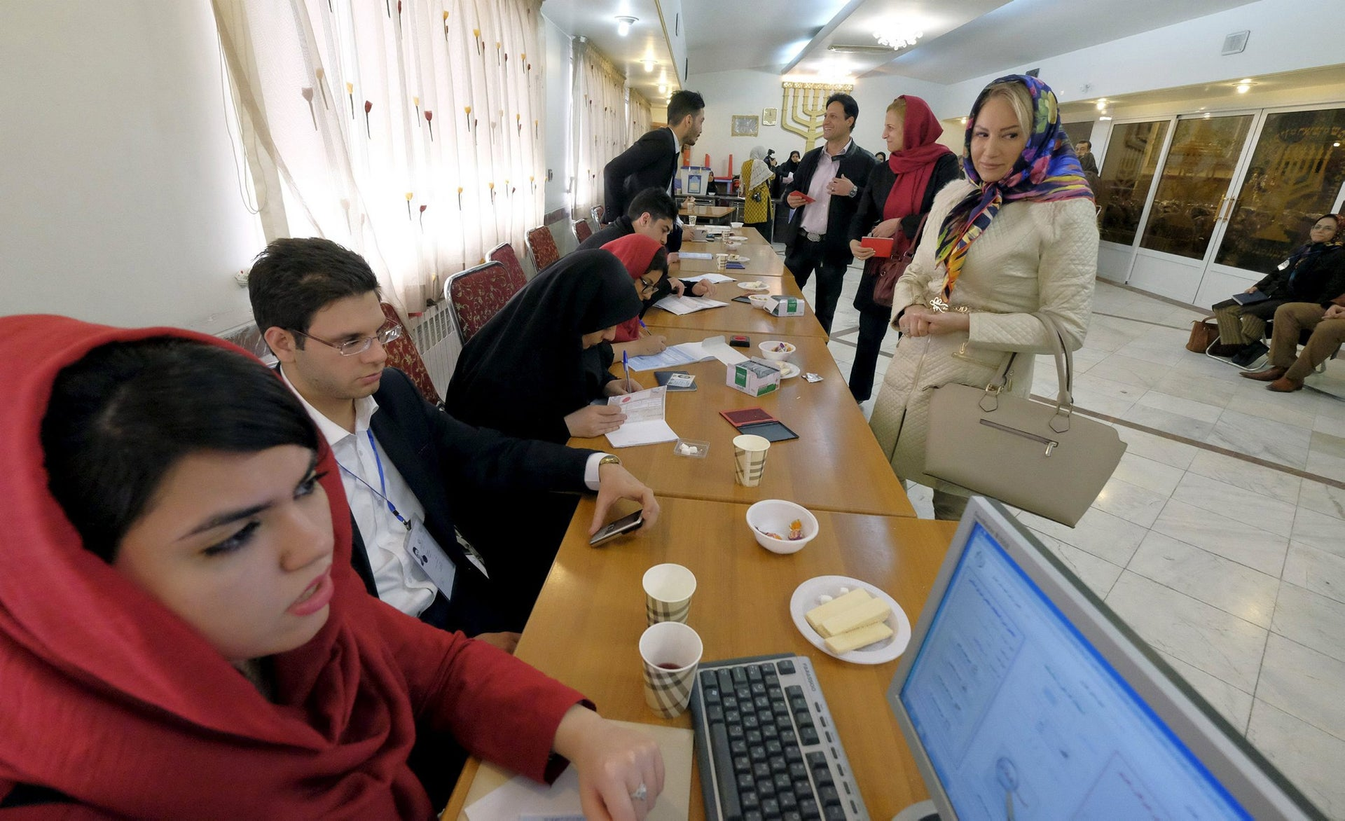 Iranian Jewish voters arrive to cast their ballots at a synagogue, used as a polling station, during elections for the parliament and Assembly of Experts, which has the power to appoint and dismiss the supreme leader, in Tehran February 26, 2016.