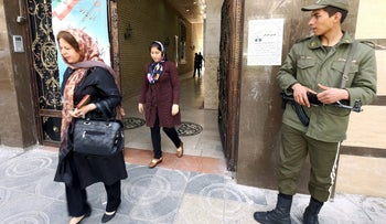 Iranian Jewish women leave a synagogue, used as a polling station, after casting their votes during elections for the parliament and Assembly of Experts, which has the power to appoint and dismiss the supreme leader, in Tehran February 26, 2016.