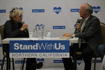 American comedian and actress Roseanne Barr with StandWithUS event moderator Lenny Kristal in California on February 27, 2016.