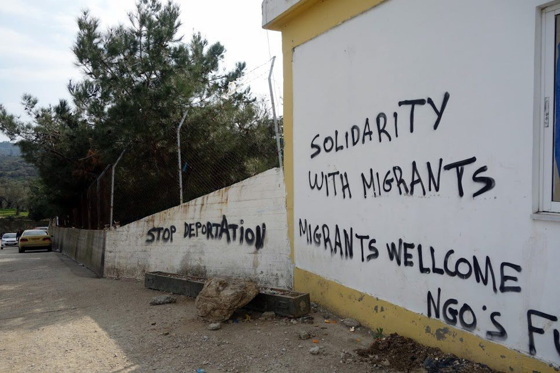 A message of welcome to refugees graffitied on a wall in Lesbos, Greece.