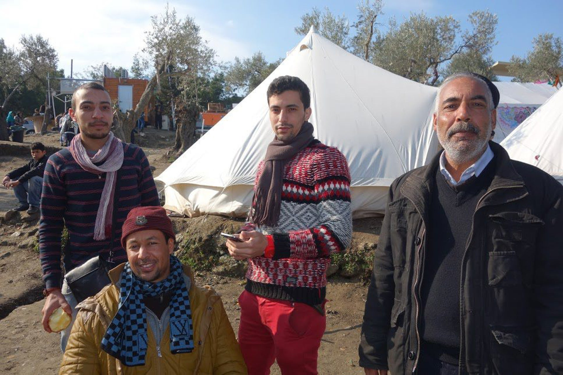 An Iraqi man (right) and three Libyan men at the main refugee camp on Lesbos.