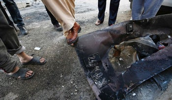 Remnants of the scorched car left behind by two IDF soldiers who accidentally entered the Qalandiyah refugee camp.