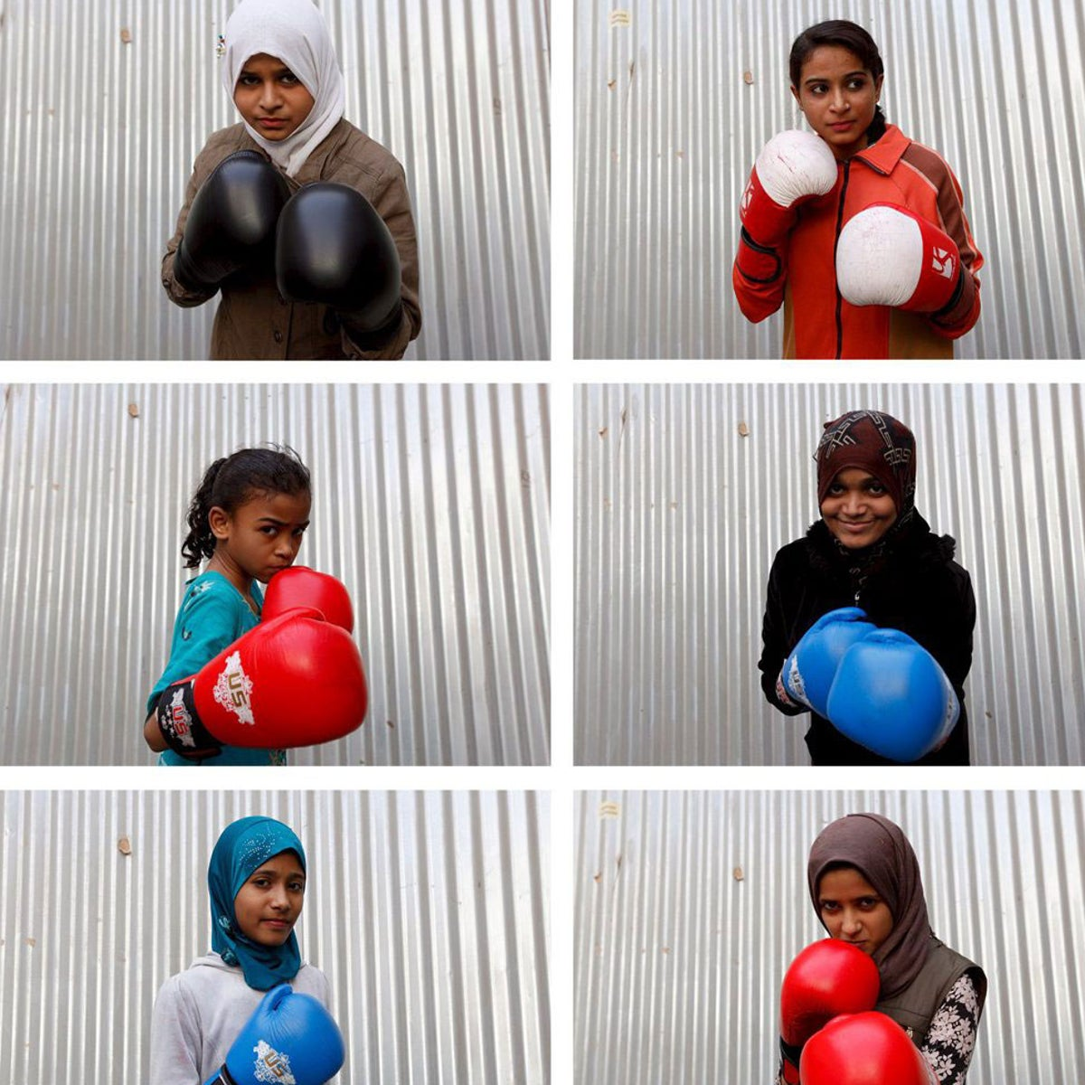 Students of coach Younus Qambrani posing with their boxing gloves at the first women's boxing coaching camp in Pak Shaheen Boxing Club in Karachi, Pakistan, February 20, 2016.