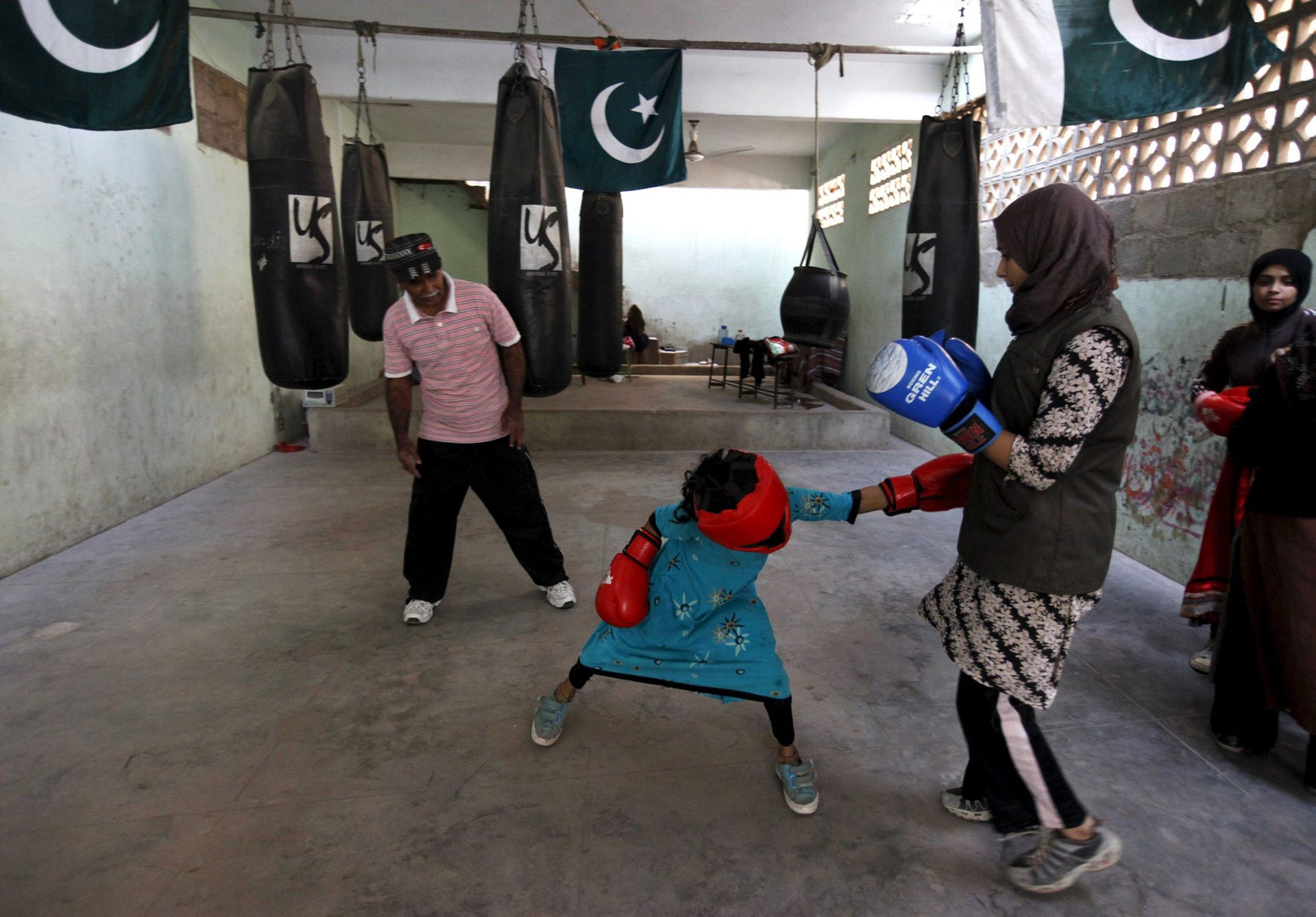 Barisha, 9, punches Misbah in a practice session at the first women's boxing camp in Karachi, Pakistan on February 20, 2016.