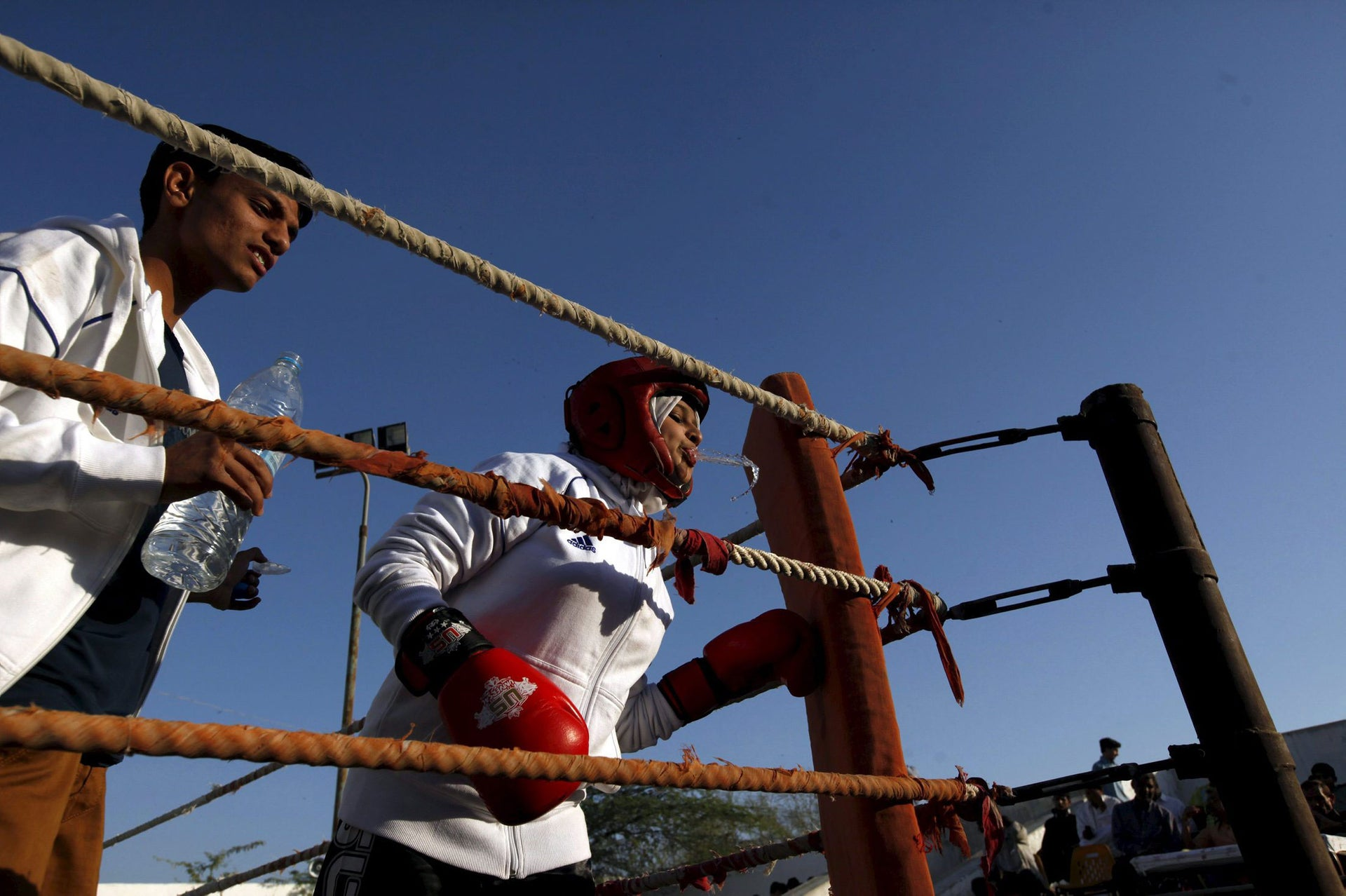 Urooj, 15, spits water between rounds in her bout during the Sindh Junior Sports Association Boxing Tournament in Karachi, Pakistan February 21, 2016.