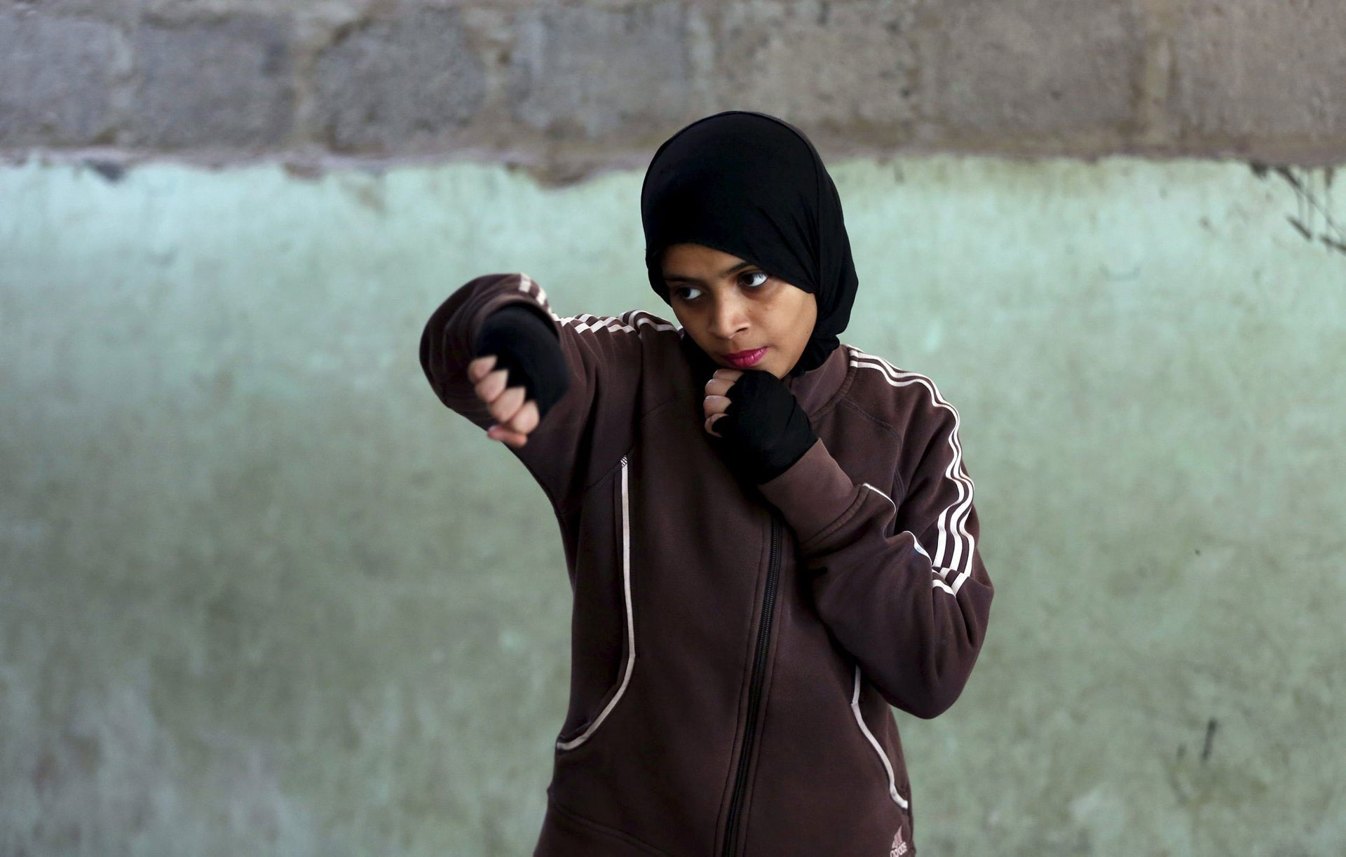Misbah, 17, does warm up exercises at the first women's boxing camp in Karachi, on February 19, 2016.