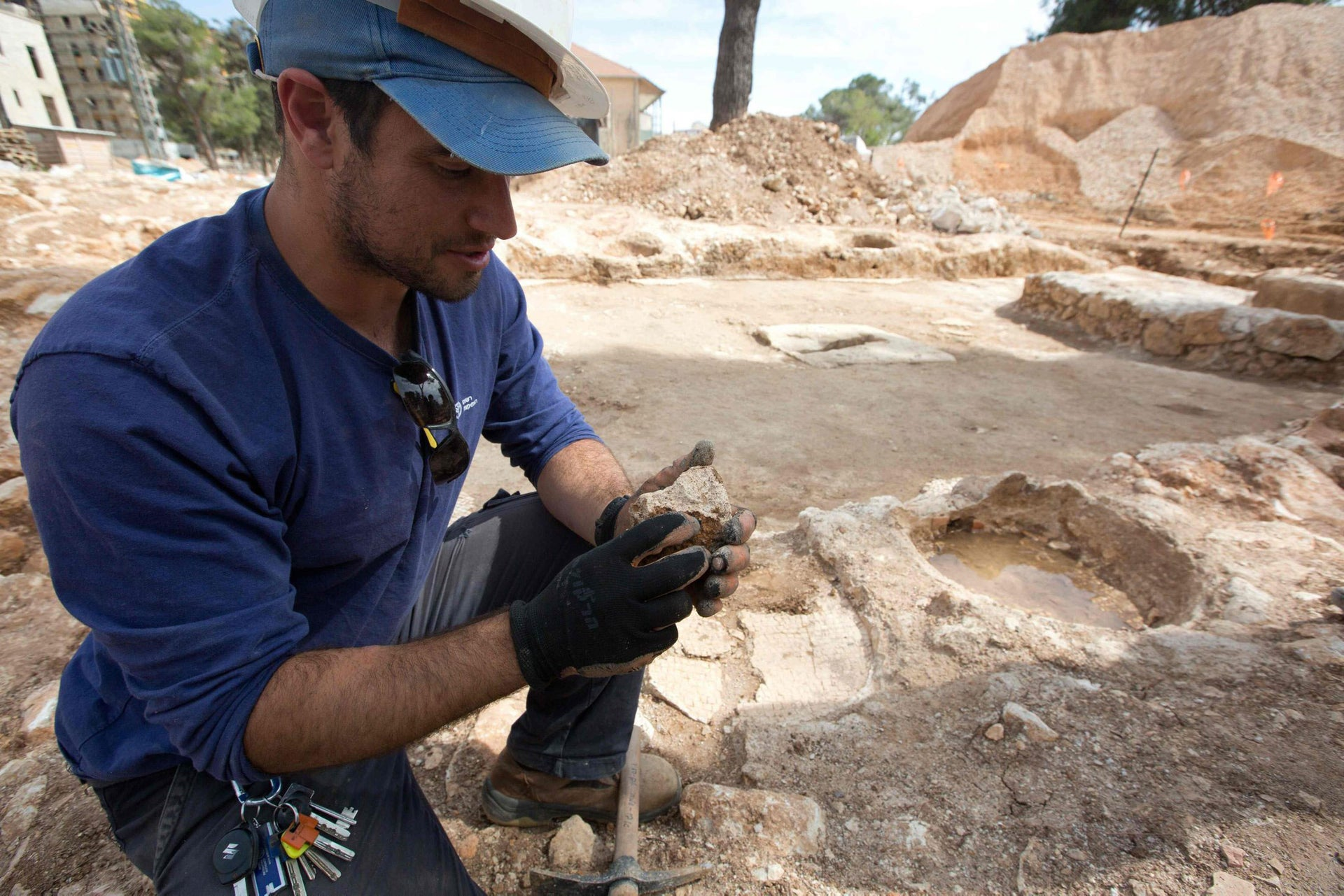 A worker with the Israeli Antiquities Authority works at the site where a large roman winery was found in Jerusalem's Schneller Compound, in the heart of construction site for new residential houses, on March 2 2016.