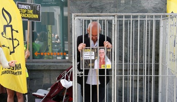 Amnesty International Belgium's Director Philippe Hensmans protests the detention of his Turkish counterpart Idil Eser in front of the Turkish embassy, Brussels, Belgium, July 10, 2017.