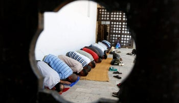 Muslim men pray during the holy fasting month of Ramadan at a mosque in Tunis, Tunisia, June 2, 2017. REUTERS/Zoubeir Souissi
