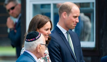 Britain's Prince William, Duke of Cambridge, and his wife Kate, the Duchess of Cambridge, visit the former Stutthof Nazi concentration camp near Gdansk, Poland, on July 18, 2017.
