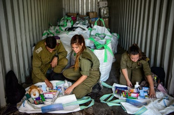 Israeli soldiers sorting supplies and toys to be sent to Syria, July 19, 2017.