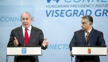 Hungarian Prime Minister Viktor Orban listens to Israeli Prime Minister Benjamin Netanyahu during a press conference with heads of government of the V4 countries in Budapest, Hungary on Wednesday, July 19, 2017.