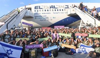 New immigrants to Israel are welcomed by Nefesh B'Nefesh at Ben Gurion Airport tarmac in August, 2016.