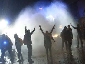 Riot police uses water cannons against protesters in the Schanze district of Hamburg following the G20 summit in Hamburg, July 9, 2017.