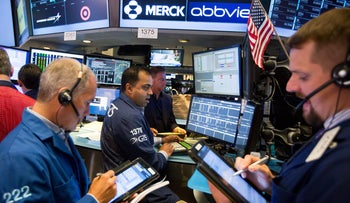 File photo: Traders work on the floor of the New York Stock Exchange (NYSE) in New York, U.S., June 23, 2017.