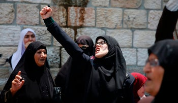 Palestinians shout slogans during a demonstration against new Israeli security measures at the Al-Aqsa mosque compound, following attack that killed two Israeli policemen, July 20, 2017