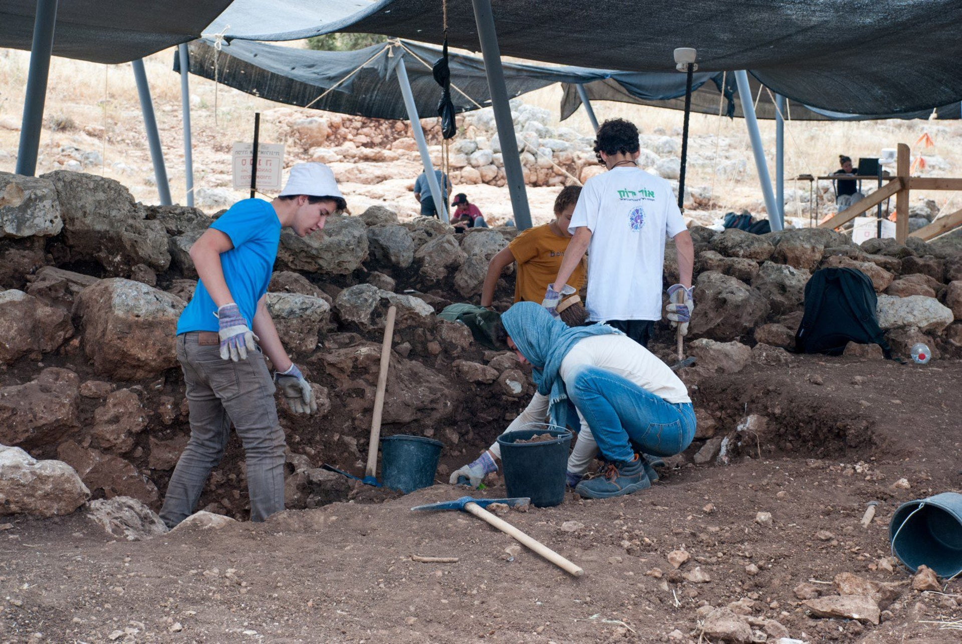Students participating in excavation of 2700-year-old water system with figurine carvings found in Rosh HaAyin.