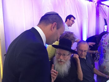 Education Minister Naftali Bennett speaks with Health Minister Yaakov Litzman at the cornerstone laying for Ariel university's medical school, June 2017.