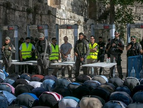 Worshippers praying outside the Temple Mount on July 14, 2017 in protest of metal detectors placed at the entrance by Israeli security forces after last week's deadly attack.