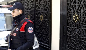 A Turkish police officer stands guard in front of Neve Shalom Synagogue in Istanbul, Turkey, March 29, 2016.