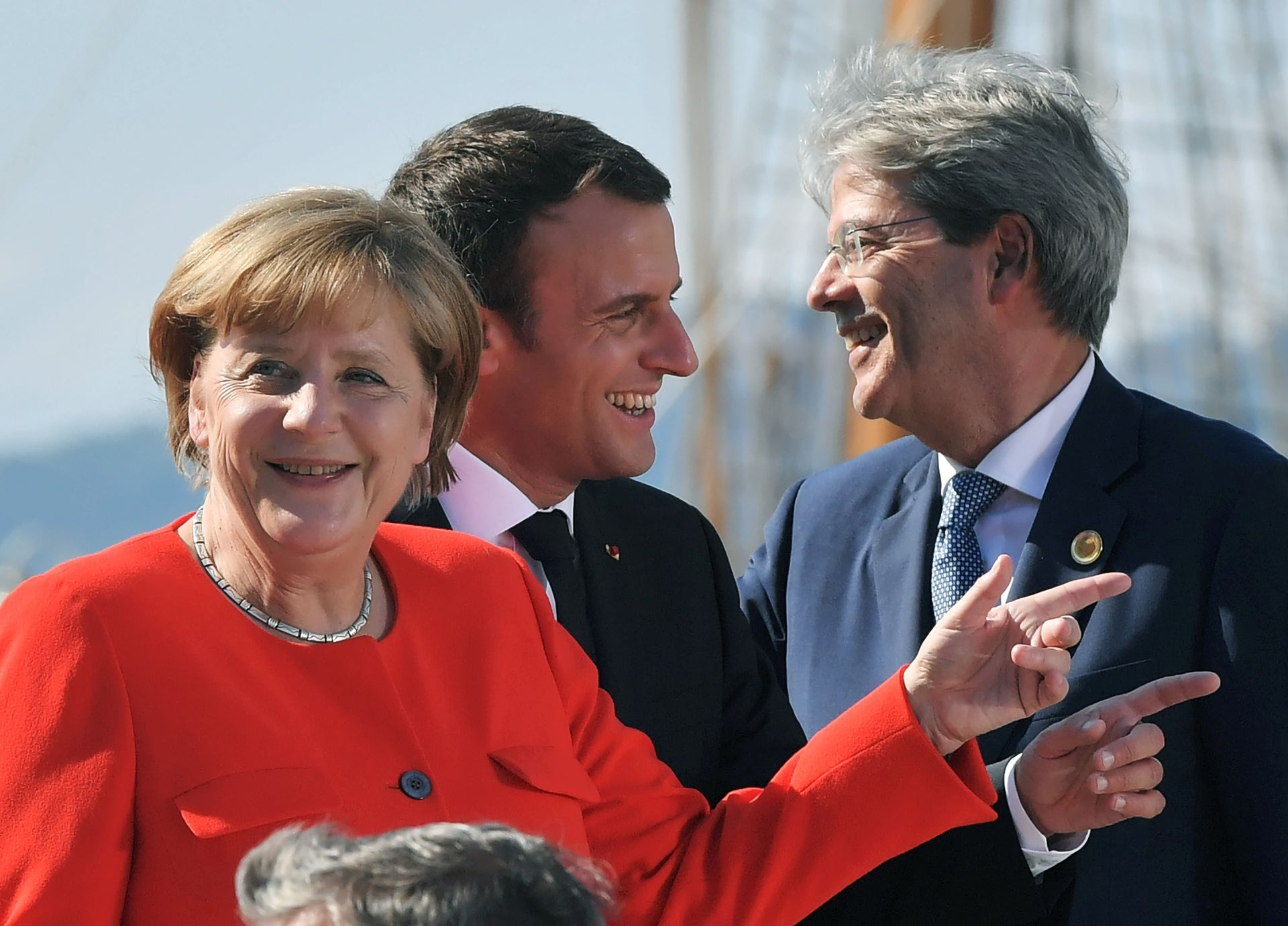 French President Emmanuel Macron, center, with Italian Prime Minister Paolo Gentiloni, right, and German Chancellor Angela Merkel during a EU-Western Balkans summit in Trieste, Italy, July 12, 2017.
